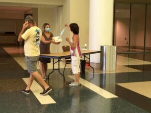In the wake of the COVID-19 pandemic, free face masks are distributed to visitors of the Ocean Center in Daytona Beach, Fla.