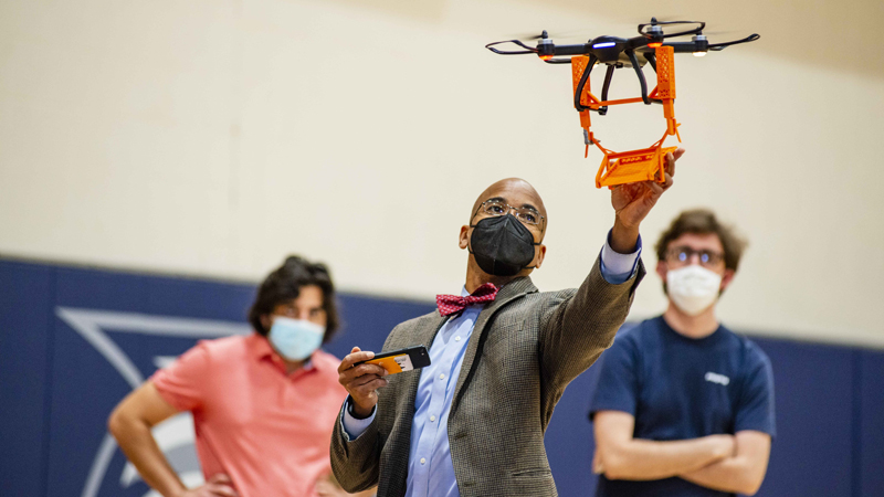 Wayne Johnson, of Georgia Southern University, conducts final drone tests of high school teams' designs for its 2021 Engineering Design Challenge. Competition participants were able to take part in the event virtually this year.